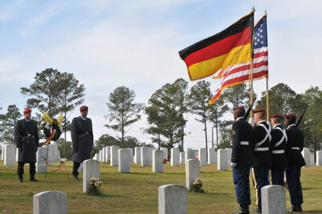 Soldiers from the 82nd Sustainment Brigade present the colors for the German memorial ceremony at Fort Bragg's Post Cemetary Nov. 7. The ceremony commemorated and recognized eight German prisoners of war soldiers who died during World War I and World War II.