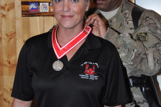 Karen Anderson, deployed to the Afghanistan Engineer District-South from March 2009 to December 2012, was presented the Steel de Fleury Medal Nov. 21 by Afghanistan Engineer District-South Commander Col. Vincent Quarles.