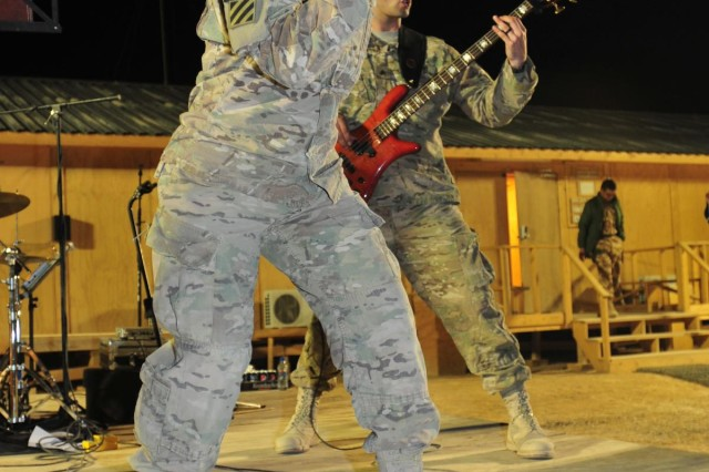 Third Infantry Division rock band members Sgt. Jessica Winkler, vocalist, and Sgt. Michael Winkler, bass guitarist, perform at Forward Operating Base Mescal, Afghanistan, Nov. 14, 2012. The band travels frequently to FOBs in Regional Command South bringing live music and entertainment to coalition forces throughout the battle space.  (U.S. Army photo by Sgt. Lori Bilyou)