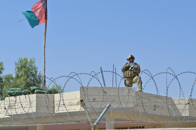 An Albanian Special Forces member provides roof-top security during a meeting with coalition forces and Afghan leaders in the Kandahar province, Afghanistan, Sept. 30, 2012.