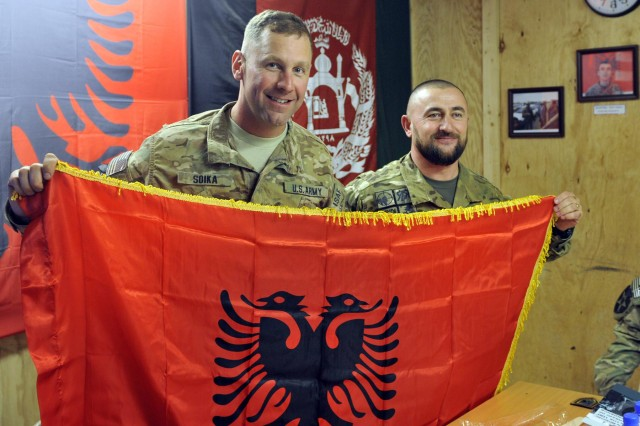 From left, U.S. Lt. Col. Steven Soika, commander of the 5th Battalion, 20th Infantry Regiment and Albanian Lt. Col. Ekland Dauti, commander of Contingent Eagle Five of the Albanian Special Operations Force pose with an Albanian decorative flag during the ALBSOF's 14th birthday celebration with coalition forces in the Kandahar province, Afghanistan, Oct. 16, 2012.