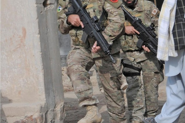 Albanian Special Forces members clear a compound of any threats prior to a meeting with coalition forces and local leaders in the Kandahar province, Afghanistan, Oct. 19, 2012.