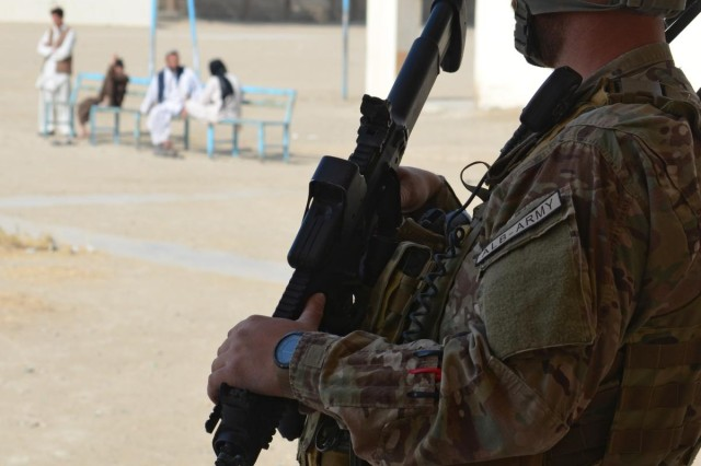 An Albanian Special Forces member provides security during a meeting with coalition forces and local leaders in the Kandahar province, Afghanistan, Oct. 19, 2012.