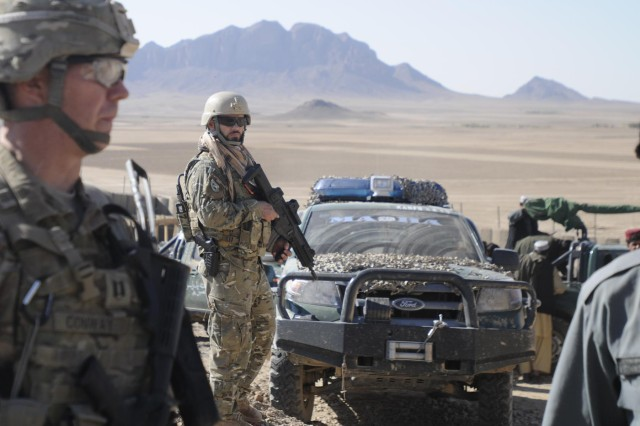 An Albanian Special Forces soldier provides security during an assessment of a police sub-station construction project with coalition forces and Afghan Uniformed Police members in Kandahar province, Afghanistan, Nov. 7, 2012.