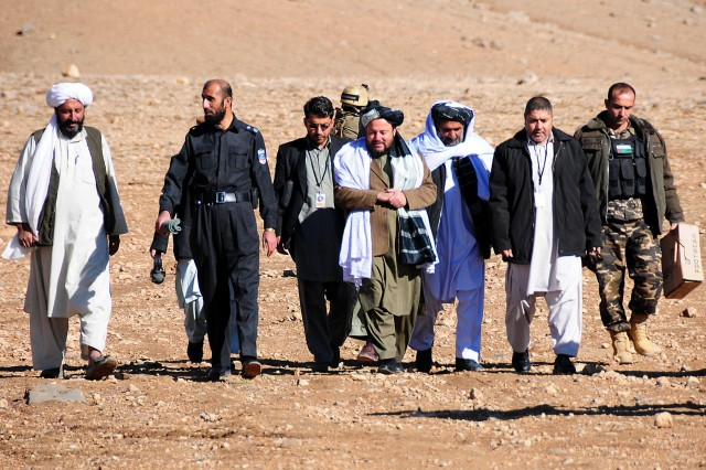 Uruzgan provincial and district level leaders along with members from Combined Team Uruzgan, Uruzgan Provincial Reconstruction Team and Special Operations Task Force Southeast conducted a visit to Khas Uruzgan district to display their support for the Afghan Peace and Reintegration Program Nov. 24, 2012.