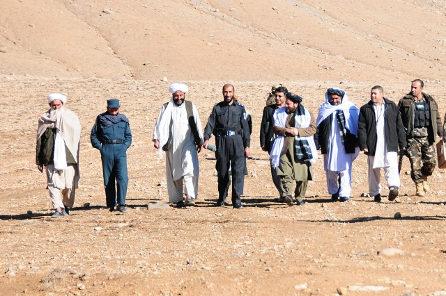 Uruzgan provincial and district level leaders along with members from Combined Team Uruzgan, Uruzgan Provincial Reconstruction Team and Special Operations Task Force Southeast conducted a visit to Khas Uruzgan district to display their support for the Afghan Peace and Reintegration Program, Nov. 24, 2012.