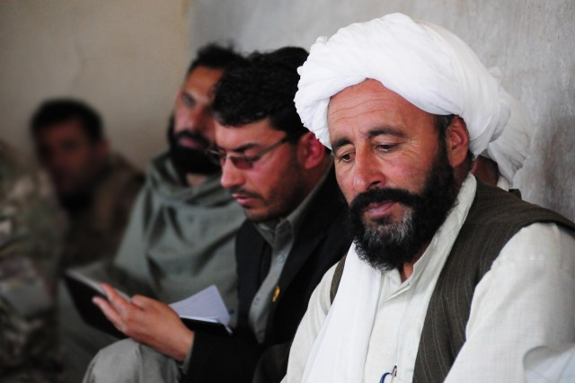 Afghan Peace and Reintegration Program reintegree and Afghan Local Police commander, Abdul Samad, meets with Uruzgan provincial and district-level leaders along with members from Combined Team Uruzgan, Uruzgan Provincial Reconstruction Team and Special Operations Task Force Southeast conducted during a shura in Khas Uruzgan district, Nov. 24, 2012.