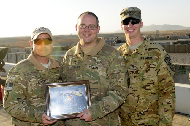 "Spc. Timothy Edwards, a UH-60 Black Hawk crew chief assigned to Company A, 2nd Battalion, 25th Aviation Regiment, Task Force Lightning Horse, 25th Combat Aviation Brigade is named the ""Top Gun"" for the 1st 25th CAB Top Gun Competition in Afghanistan, Nov. 30."