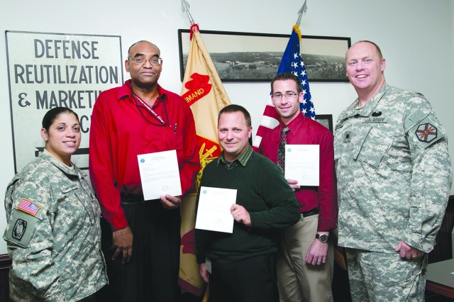 Garrison Commander Lt. Col. Jason Mackay recently presented certificates of appreciation to three members of the Community Emergency Response Team for participating in this summer's Force Protection exercise held on post. From left, Command Sgt. Maj. Rosalba Dumont-Carrion, Gordon E. James, Jason Mackie and David Charowsky.