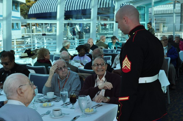 Veterans from the Armed Forces Retirement Home of Washington, D.C., swap stories with a Marine Corps sergeant aboard the Odyssey for the annual Patriot's Thanksgiving Luncheon Cruise Nov. 20.