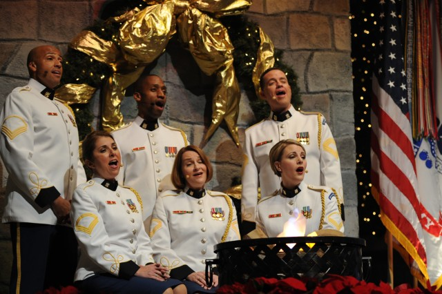 """""""Pershing's Own"""" Army Voices perform 'A Gleeful Christmas"""" at the annual American Holiday Festival performed by the U.S. Army Band at DAR Constitution Hall in Washington, D.C., Nov. 30-Dec. 2. Front Row:  Sgt. 1st Class Holly Shockey, Sgt. 1st Class Leigh Ann Hinton and Staff Sgt. Pamela Terry. Back Row: Staff Sgt. (P) A. Miles Simmons, Staff Sgt. Andre McRae and Master Sgt. Michael Ford."""