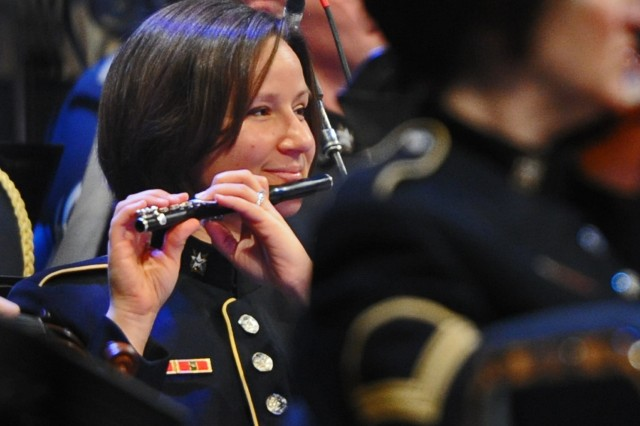 """A """"Pershing's Own"""" member Staff Sgt. Elizabeth McGinness plays piccolo of the U.S. Army Band performs at the annual American Holiday Festival at DAR Constitution Hall in Washington, D.C., Dec. 2."""