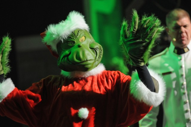 """Dr. Seuss's Grinch (Staff Sgt. Martha Krabill) joined """"Pershing's Own"""" on stage at DAR Constitution Hall where the Army Band put on a four-show American Holiday Festival Nov. 30 - Dec. 2."""
