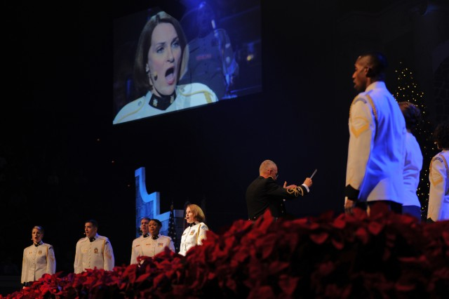 """Sgt. 1st Class Leigh Ann Hinton sings 'O Holy Night during """"Pershings Own"""" American Holiday Festival at DAR Constitituion Hall in Washington, D.C., Dec. 2."""