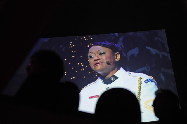 """Sgt. 1st Class Christal Rheams sings """"Joy to the World"""" during the U.S. Army Band """"Pershing's Own"""" annual American Holiday Festival, a four-show gala at DAR Constitution Hall in Washington, D.C., Nov. 30 - Dec. 2."""
