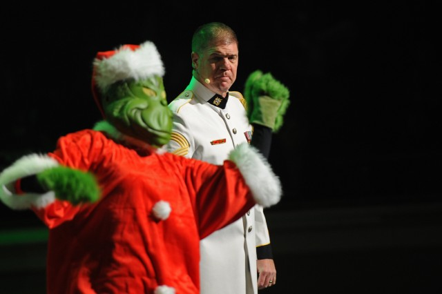 """Dr. Seuss's Grinch dances to Master Sgt. Greg Lowery's rendition of """"You're a Mean One, Mr. Grinch,"""" at the U.S. Army Band """"Pershing's Own"""" annual American Holiday Festival held at DAR Constitution Hall in Washington, D.C., Nov. 30 - Dec. 2."""