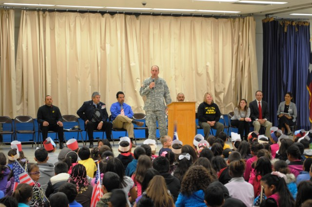 "Sgt. Maj. Riley Woodworth, 1st Battalion, 360th Infantry Regiment sergeant major, discusses ""pride in community"" with the students at Collins Elementary School during their recent Veterans Day ceremony in El Paso, Texas. (Photo by Staff Sgt. Robert L. Baker, 1st Battalion, 360th Infantry Regiment, Task Force Warhawg, 5th Armored Brigade, Division West)"