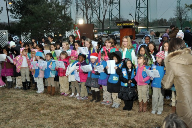 Girl Scouts sing Christmas carols during the Yongsan Tree Lighting Ceremony, Nov. 30. (U.S. Army photo by Cpl. Lee Hyokang)