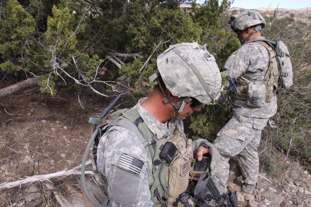 A Soldier from 2nd Brigade, 1st Armored Division uses a Nett Warrior handheld connected to a Rifleman Radio to pass information during operations at the Army's Network Integration Evaluation (NIE) 13.1 on Nov. 9, 2012. Although the final technical evaluations and responses are still pending, the Army is reviewing early assessments from NIE 13.1, which concluded Nov. 17, and planning for NIE 13.2, which gets underway in May 2013.