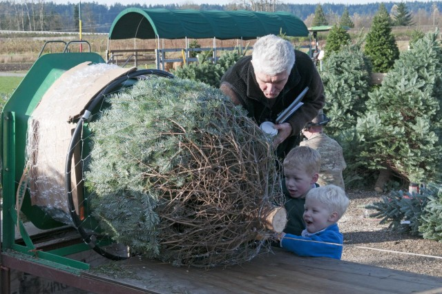 A grower from Schilter Family Farm bundles a Christmas tree for delivery to soldiers from 3rd Brigade, 2nd Infantry Division, Joint-Base Lewis-McChord, Wash., Nov. 26, 2012. The half dozen trees were cut down by Wounded Warriors - soldiers from 3rd Brigade who incurred some kind of injury while serving in Afghanistan - and will be displayed at their respective battalions throughout the holiday season. (U.S. Army photo by Sgt. Chris McCullough, Arrowhead Brigade Public Affairs)