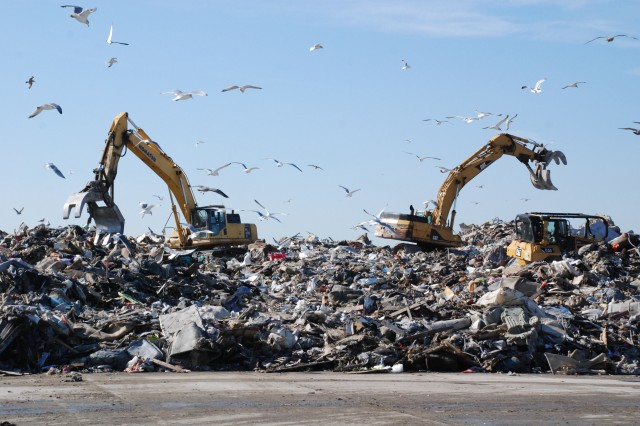 Debris is collected and then loaded onto trucks at Jacob Riis Park in Far Rockaway in Queens, N.Y., for shipping to landfills. The U.S. Army Corps of Engineers provided debris removal assistance after Hurricane Sandy as part of a FEMA mission assignment.