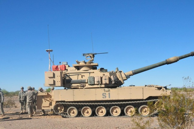 Soldiers of Battery A, 4th Battalion, 27th Field Artillery Regiment, 2nd Brigade Combat Team, 1st Armored Division, conduct an after-action review after an iteration of firing with the M109 Paladin Integrated Management Howitzer system, a proposed upgrade to the current M109A6 Paladin that is being tested for reliability, availability and maintainability.