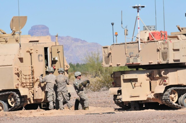 Soldiers of Battery A, 4th Battalion, 27th Field Artillery Regiment, 2nd Brigade Combat Team, 1st Armored Division, prepare the M109 Paladin Integrated Management Howitzer with rounds for firing during testing at Yuma Proving Ground, Ariz. The soldiers of 4-27 FA were selected for the testing mission due to their proficiency at field artillery tasks as well as their familiarity with testing and providing candid, constructive feedback.