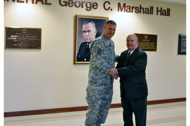 FORT BRAGG, N.C. (Dec. 4, 2012) - Gen. David M. Rodriguez, U.S. Army Forces Command Commanding General, officially welcomes the Honorable Dr. Joseph W. Westphal, Under Secretary of the Army, to FORSCOM's Marshall Hall headquarters at Fort Bragg, N.C.  Dr. Westphal is here to discuss the U.S. Army's Regional Alignment and support to Combatant Commanders.  Later in the day, Dr. Westphal will also visit other units at Fort Bragg to include; the U.S. Army John F. Kennedy Special Warfare Center and School, the Joint Special Operations Medical Training Center, and the XVIII Airborne Corps.
