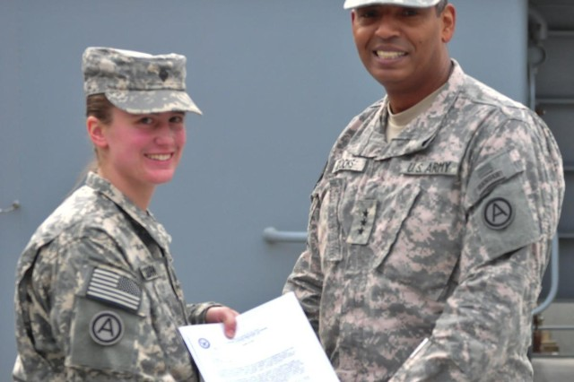 Spc. Erin Colburn, an intelligence analyst specialist New York Army National Guard's 27th Brigade Special Troops Battalion, receives a letter of conditional acceptance to West Point by Lt. Gen. Vincent K. Brooks, commanding general of Third Army/ARCENT, and a graduate of the Academy, himself. Colburn, who plans to study geospatial intelligence, is slated to begin her career at West Point in July 2013.