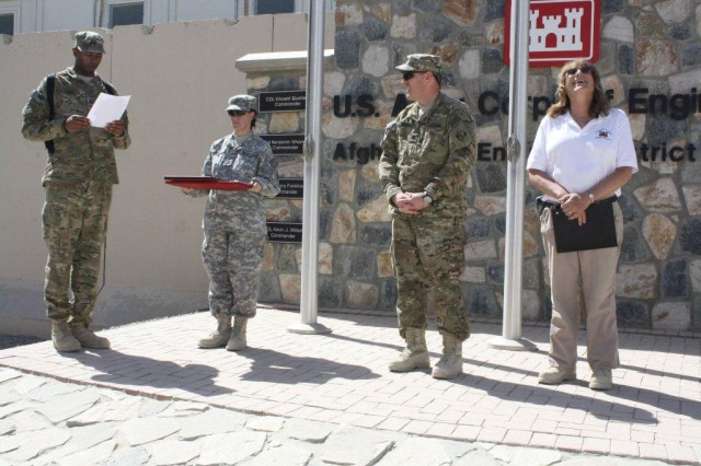 Jean Brockner (right), a Buffalo District Contract Specialist deployed as a procurement technician to the Corps' Afghan South District, Kandahar, Afghanistan recieves an award for improving fire safety on the base.