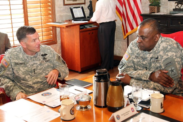 "FORT SAM HOUSTON, Texas - Lt. Gen. William Caldwell IV (left), commanding general, U.S. Army North, and senior commander, Fort Sam Houston and Camp Bullis, explains Army North's role in the defense of the homeland to Gen. Lloyd Austin III, vice chief of staff, U.S. Army, during Austin's visit Dec. 3 to Fort Sam Houston. Austin told Caldwell that he was grateful for the hard work of Army North professionals during the military response to Hurricane Sandy. ""You made us all proud,"" Austin said.  (U.S. Army photo by Sgt. Lee Ezzell, Army North PAO)"