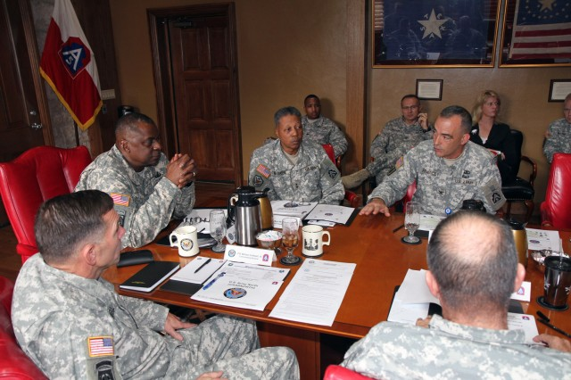 FORT SAM HOUSTON, Texas - Col. Richard Francey (seated, far right), chief of staff, U.S. Army North, explains some of the strengths Army North possesses in its mission of homeland defense to Gen. Lloyd Austin III (head of table), vice chief of staff, U.S. Army, during Austin's visit Dec. 3 to Fort Sam Houston.  (U.S. Army photo by Sgt. Lee Ezzell, Army North PAO)
