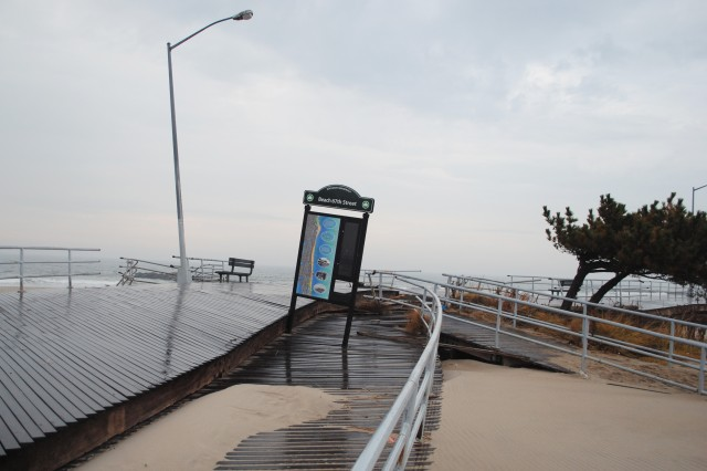 Rockaway Beach Boardwalk at Beach 67th Street lays buckled Dec. 5 after last month's Hurricane Sandy. Now the U.S. Army Corps of Engineers is working with contracted crews to dispose of the wood planks and busted-up concrete that were left behind.