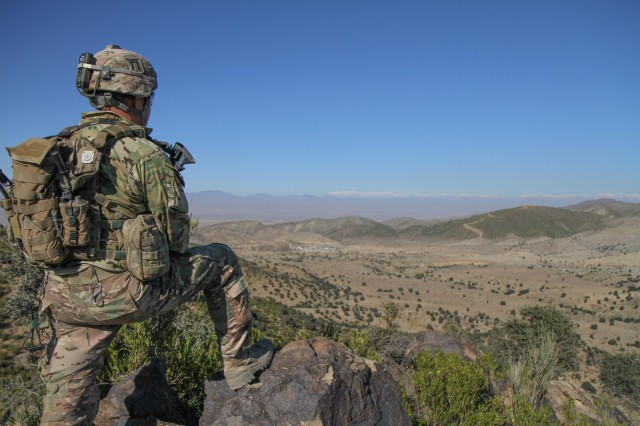 """KHOWST PROVINCE, Afghanistan """" Sgt. 1st Class Duane O'Keefe, an infantry platoon sergeant assigned to Company C, 3rd Battalion, 187th Infantry Regiment, 3rd Brigade Combat Team """"Rakkasans,"""" 101st Airborne Division (Air Assault), looks into a nearby valley for signs of insurgent activity near Combat Outpost Bowri Tana, Afghanistan, Nov. 30, 2012. Soldiers from Company C conducted a security patrol in search of the site where a rocket was fired from during a recent attack on their combat outpost. (U.S. Army photo by Sgt. 1st Class Abram Pinnington, Task Force 3/101 Public Affairs)"""