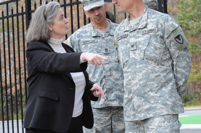 Kathryn Condon discusses the new Army cemetery procedures with Anniston Army Depot Commander Col. Brent Bolander and Sgt. Maj. Jeffrey Marcon.