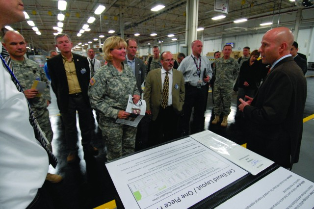 Ed Kraftchisin, Tobyhanna Army Depot, briefs Lt. Gen. Patricia E. McQuistion, deputy commanding general of the U.S. Army Materiel Command, and other AMC officials on process improvements in the depot's Tactical End Item Repair Facility during the Depot Assessment Visit held Dec. 4-5.