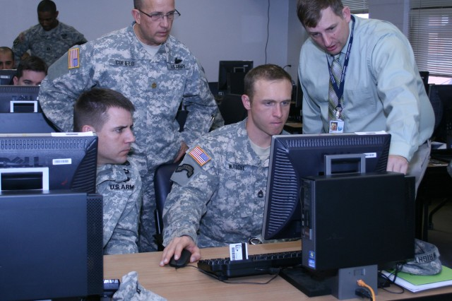 FORT CARSON, Colo. -- Joel Young, right, Training Management Mobile Training Team, helps officers and noncommissioned officers navigate digital training systems to better organize and plan for unit training missions. Young and other team members traveled to Fort Carson from the Training Management Directorate at the Combined Arms Center for Training, headquartered at Fort Leavenworth, Kan.