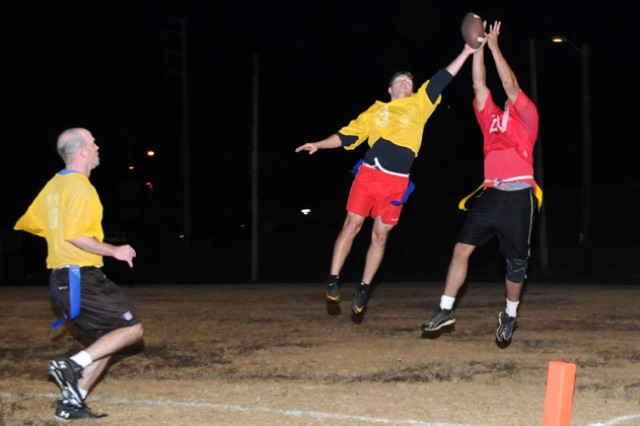 Capt. Walter Thomas, A Co., 1st Battalion, 145th Aviation Regiment team captain, picks off a pass during the Fort Rucker intramural football championship game at the Fort Rucker Physical Fitness Facility Nov. 28. A Co. won the championship by winning two games in the double elimination tournament against the Bama Bombers.