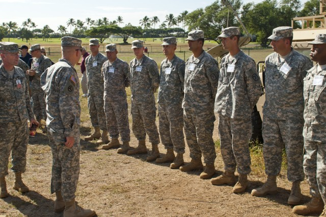 Col. Charles Maskell, deputy commander of the 8th Theater Sustainment Command, commends the Soldiers of the 545th Harbormaster Detachment, 524th Combat Sustainment Support Battalion, 45th Sustainment Brigade, 8th TSC, after a tour the Harbormaster Command and Control Center, a new piece of equipment given to the detachment, Oct. 24, at Ford Island.