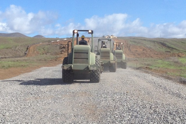 Soldiers with 2nd Squad, 1st Platoon, 561st Engineer Company, 84th Engineer Battalion, 130th Engineer Brigade, 8th Theater Sustainment Command, compact the road way to complete the Keamuku Main Supply Route of the Pohakuloa Training Area on the Big Island, Oct. 26.