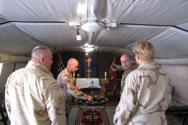 While visiting the Norwegian/Swedish Chapel, the Norwegian Chaplain explains  the tradition and meaning behind lighting candles and then invited those who wanted to light a candle as an act of prayer.