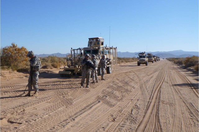 Soldiers of 3rd Platoon, 704th Engineer Company, use handheld mine detectors to check for explosives on a convoy route during a route clearance training exercise Nov. 29.