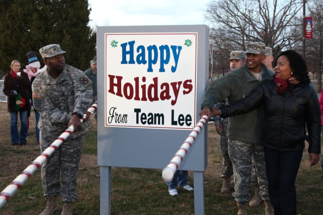 Maj. Gen. Larry D. Wyche, Combined Arms Support Command and Fort Lee commanding general, is assisted by his wife, Denise, and Spc. Willie J. Rodgers III, Headquarters and Headquarters Company, U.S. Army Garrison Fort Lee, in pulling the levers to light the Fort Lee holiday tree Dec. 6. In conjunction with the tree lighting, guests were treated to hot chocolate, cookies, caroling and a visit from Santa Claus. The event was Fort Lee's kickoff to the holiday season and was hosted on the front lawn of the Lee Club.