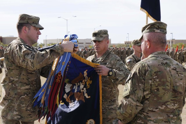 Lt. Col. James Van Atta, 4th Battalion, 17th Infantry Regiment (Buffalos),  battalion commander cases his battalion colors alongside Col. Ken Adgie, 1st Brigade Combat Team, 1st Armored Division commander and Command Sgt. Maj. Michael Oldsen, battalion command sergeant major, during a ceremony at Fort Bliss, Texas, Dec. 4.  The ceremony was held to signify the brigade's upcoming deployment to Afghanistan.