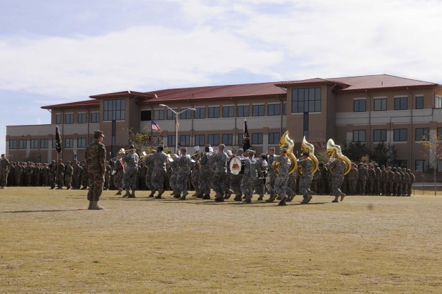 The 1st Armored Division Band marches during the casing ceremony for 1st Brigade Combat Team, 1st Armored Division, at Fort Bliss, Texas, Dec. 4.  The ceremony was held to signify the brigade's upcoming deployment to Afghanistan.