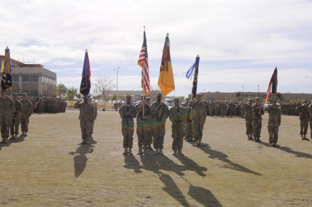 The color guard stands in formation during the casing ceremony for 1st Brigade Combat Team, 1st Armored Division, at Fort Bliss, Texas, Dec. 4.  The ceremony was held to signify the brigade's upcoming deployment to Afghanistan.