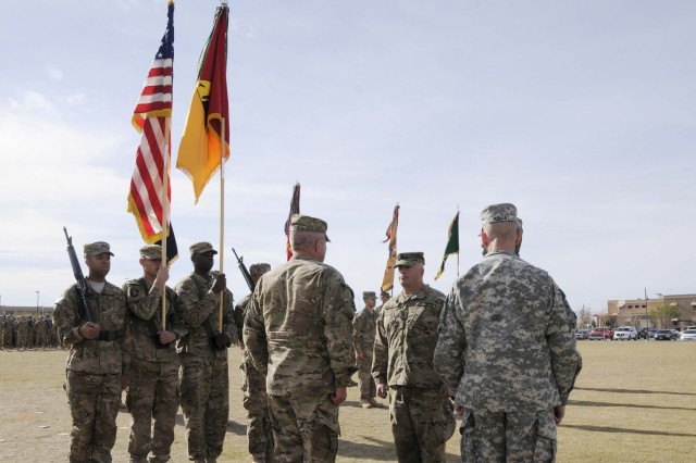 Col. Ken Adgie, 1st Brigade Combat Team, 1st Armored Division commander, prepares to case his brigade's colors during a casing ceremony at Fort Bliss, Texas, Dec. 4.  The ceremony was held to signify the brigade's upcoming deployment to Afghanistan.