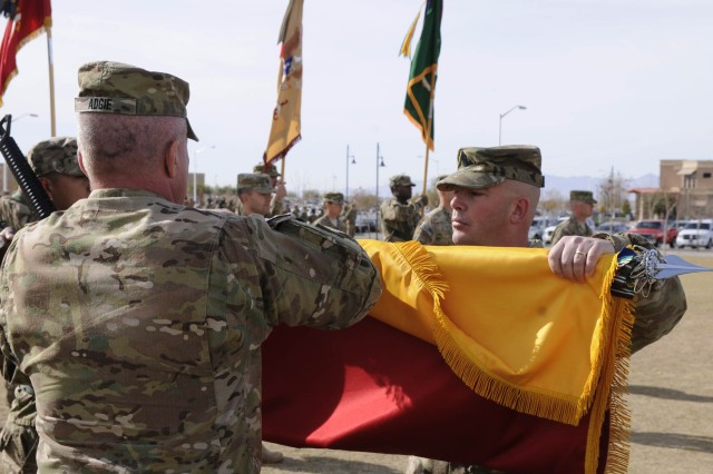Col. Ken Adgie, 1st Brigade Combat Team, 1st Armored Division brigade commander, cases his brigade colors with Command Sgt. Maj. Russell Reimers, brigade command sergeant major, during a ceremony at Fort Bliss, Texas, Dec. 4.  The ceremony was held to signify the brigade's upcoming deployment to Afghanistan.