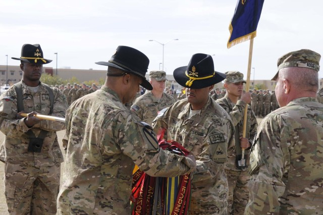 Lt. Col. Kevin A. Wallace, 6th Squadron, 1st Cavalry Regiment (Blackhawks), battalion commander, cases his colors with Command Sgt. Maj. Uhuru C. Salmon, battalion command sergeant major, and Col. Ken Adgie, 1st Brigade Combat Team, 1st Armored Division brigade commander, during a ceremony at Fort Bliss, Texas, Dec. 4.  The ceremony was held to signify the brigade's upcoming deployment to Afghanistan.