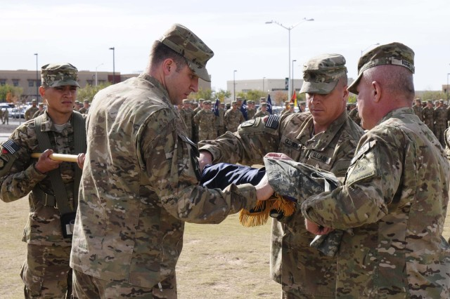 Lt. Col. James Van Atta, 4th Battalion, 17th Infantry Regiment (Buffalos),  commander cases his battalion colors alongside Col. Ken Adgie, 1st Brigade Combat Team, 1st Armored Division commander and Command Sgt. Maj. Michael Oldsen, battalion command sergeant major, during a ceremony at Fort Bliss, Texas, Dec. 4.  The ceremony was held to signify the brigade's upcoming deployment to Afghanistan.